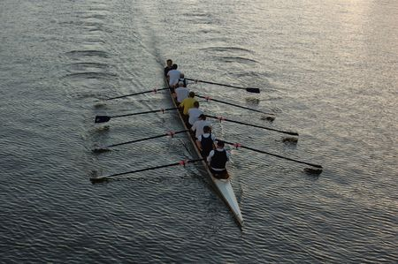 Early morning rowers training on the river. Stock Photo