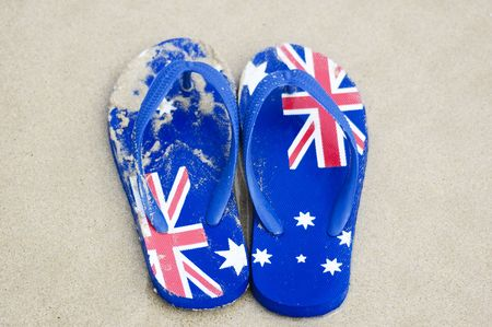 thongs: A pair of sandals decorated with the Australian flag.