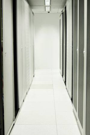 Two rows of server racks in a modern data centre. Stock Photo