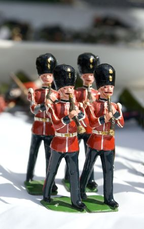 toy soldier: Collection of small toy figurines of typical English soldier marching band Stock Photo
