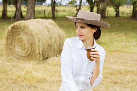 A typical Argentinean gaucha (cowgirl) drinking yerba mate Stock Photo