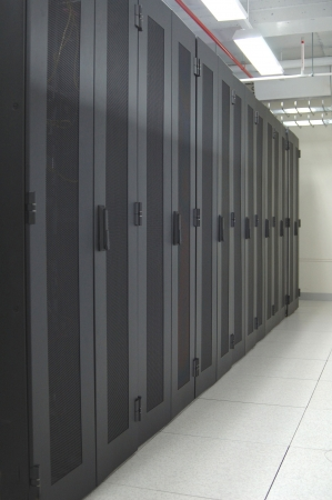 An row of racks in a commercial data center securely housing computers and servers