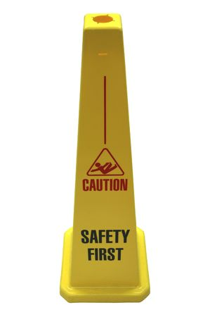 A plastic yellow self-standing safety sign featuring the words Caution, Safety First, isolated on white