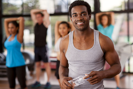 Young African-American man in a gym preparing to exercise Stock Photo