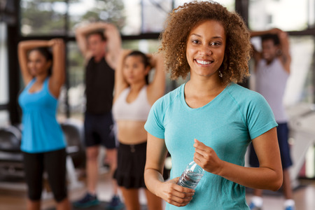 Young mixed-race woman in a gym preparing to exercise