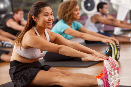 Young asian woman stretching in a gym Stock Photo