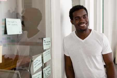 Young African American entrepreneur in his startup office smiling Stock Photo