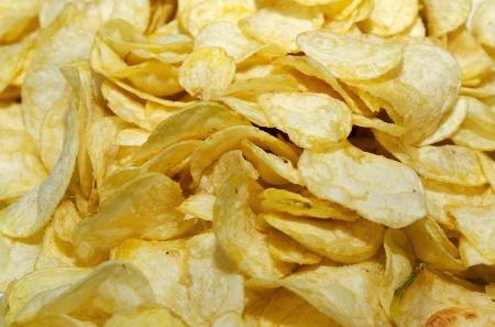fried snack: potato crispy fried snack slice rustic background