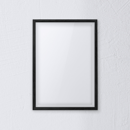 framework picture with black frame on white wall