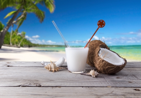 cocktail made with coconut as background a tropical landscape