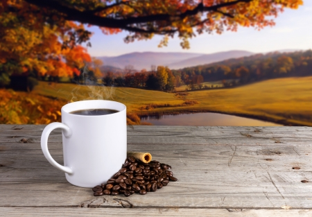 Coffee in white cup ceramic old wooden table with view landscape autumn