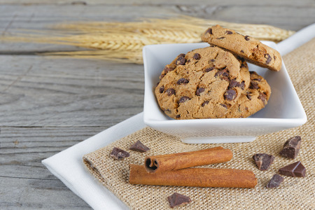 composition bowl of cookies on wooden table photo