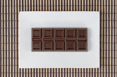 bar top: top view of bar chocolate on wooden background