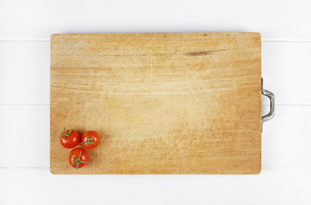 tomatoes on wooden cutting board viewed from above photo