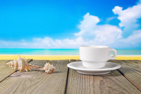 close up of white coffee cup on wooden table with landscape Stok Fotoğraf - 28488388