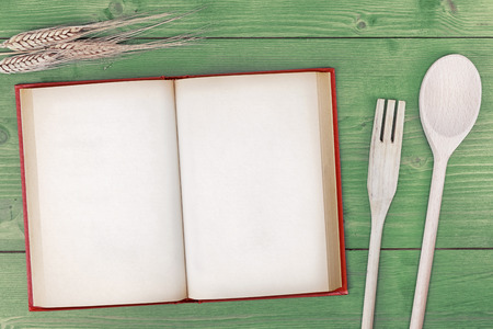 recipe book top view on wooden table photo