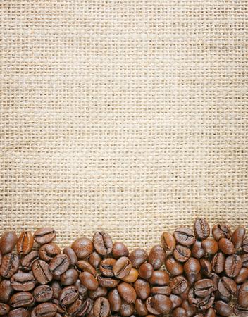 closeup top view coffee beans on juta background