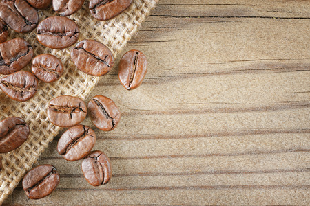 closeup top view coffee beans on wood background