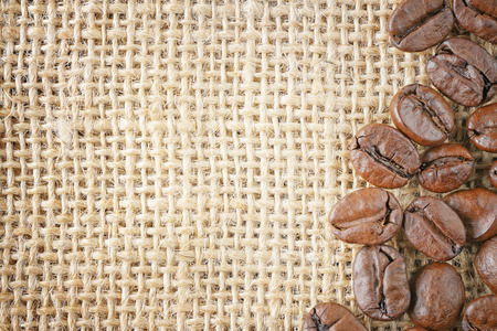 closeup top view coffee beans on jute background