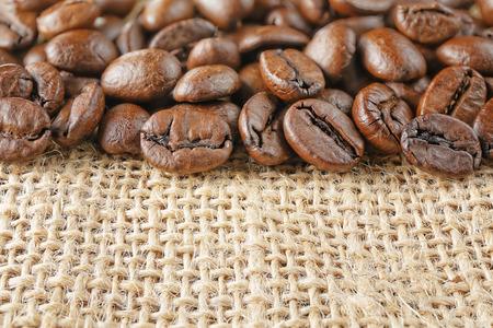 closeup macro coffee beans on juta background