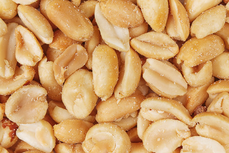 top view salted peanuts peeled full background