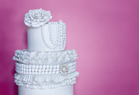Wedding cake with luxury decorated on pink background