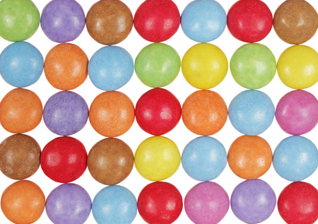 top view multicolor candy isolated on white background