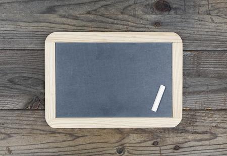 Small blackboard chalkboard on wooden texture background Stok Fotoğraf