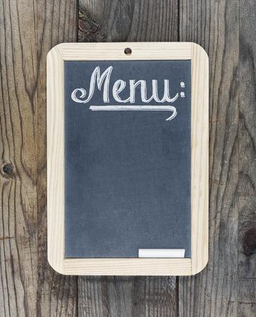 Blackboard chalkboard with text menu on wooden background Stok Fotoğraf