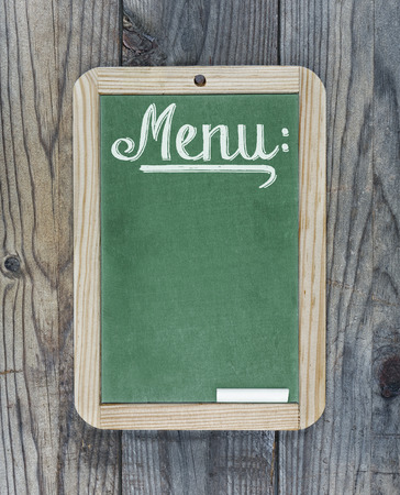 Chalkboard green with text menu on wooden background