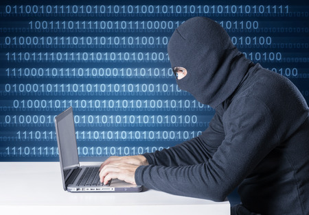 hacker with laptop computer and background binary code