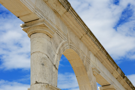 Detail of a Roman monument arc with sky