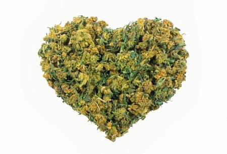 Marijuana heart shape isolated on white background Foto de archivo