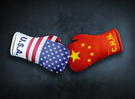 Boxing gloves with China and USA flag conflict conpet Stock Photo