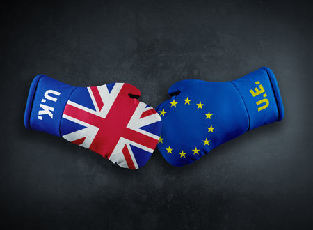 Boxing gloves with European Union and United Kingdom conflict brexit conpet