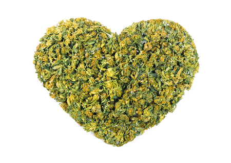 Marijuana flowers in the shape of heart isolated on white background