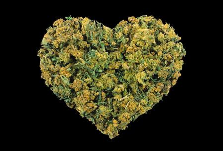Marijuana heart shape isolated on black background Stok Fotoğraf