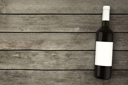 Wine bottle on wooden table top view