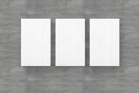 Three empty canvas on concrete wall mockup presentation