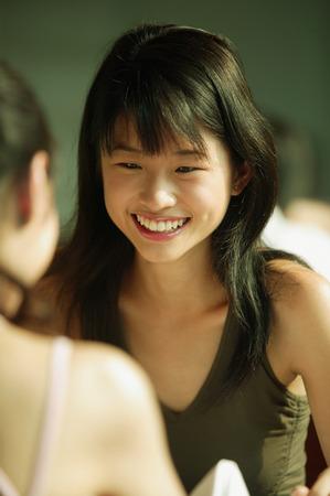 Young women talking.