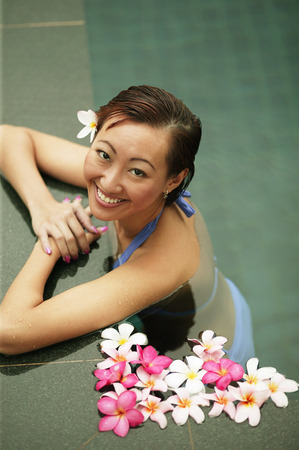 Young woman in a  swimming pool, high angle view