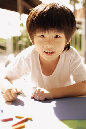 3 4 years: Young boy looking at camera