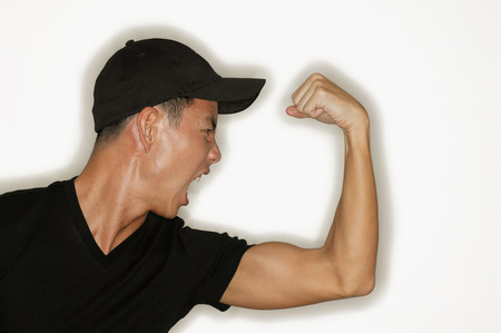 flexing: Young man flexing muscles, mouth open