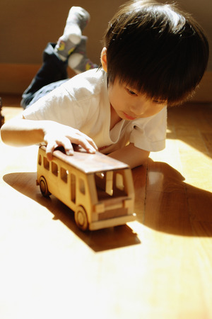 3 4 years: Young boy playing with toy bus