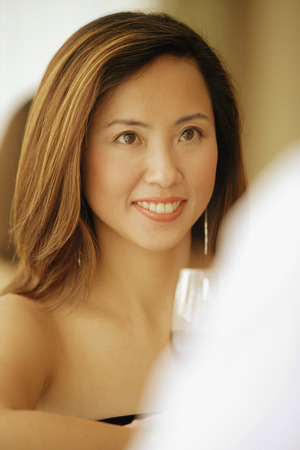 front facing: Woman facing man, glass of wine in front of her LANG_EVOIMAGES