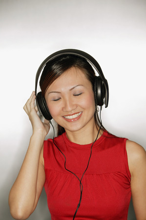 Young woman wearing headphones,  smiling