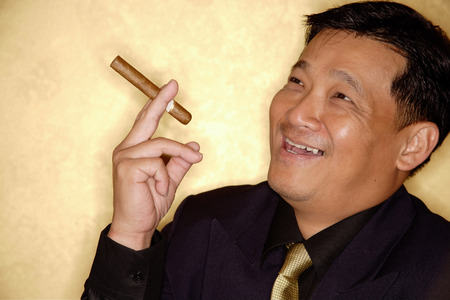 Man with cigar looking away, smiling