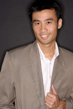 southeast asian ethnicity: Executive looking at camera, portrait LANG_EVOIMAGES