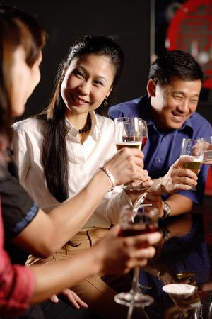 Couples having drinks at bar