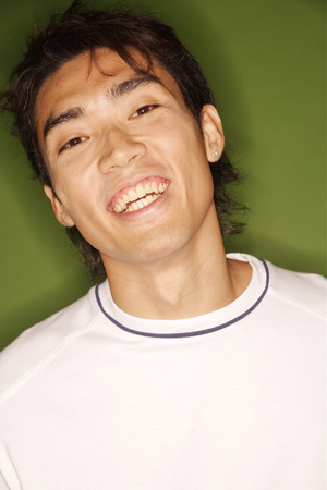 southeast asian ethnicity: Young man looking at camera, smiling, portrait